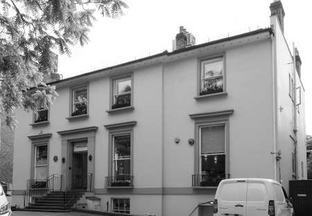 the beatles: LONDON, UK - JUNE 10, 2015: Abbey Road recording studios made famous by the 1969 Beatles album in black and white