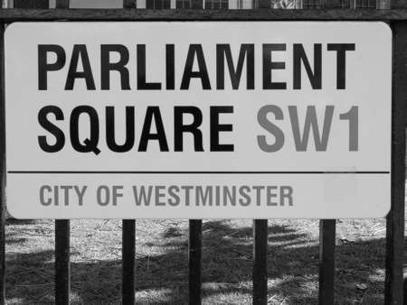 parliament square: LONDON, UK - JUNE 09, 2015: Parliament Square sign in the City of Westminster in black and white Editorial