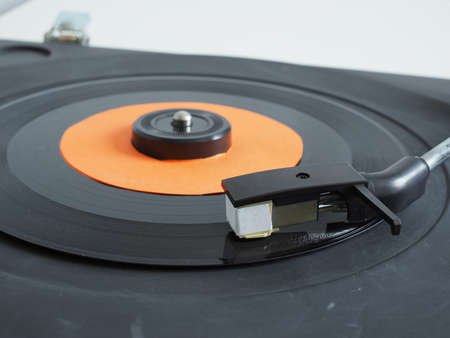 record player: Vinyl record on a turntable record player, single 45rpm disc