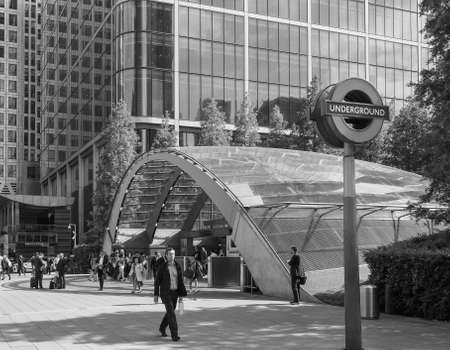 canary wharf: LONDON, UK - JUNE 10, 2015: Travellers at Canary Wharf underground station in black and white Editorial