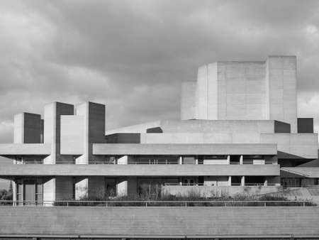 sir: LONDON, UK - JUNE 09, 2015: The National Theatre designed by Sir Denys Lasdun is a masterpiece of new brutalist architecture in black and white