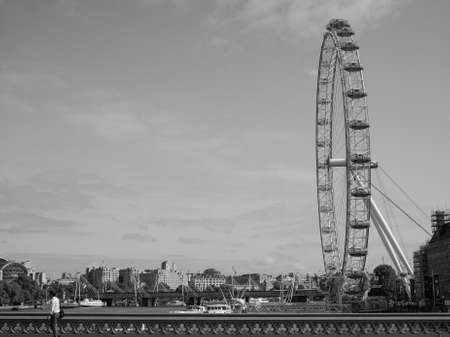aeronautical: LONDON, UK - JUNE 10, 2015: The London Eye ferris wheel on the South Bank of River Thames aka Millennium Wheel built in 1999 using advanced aeronautical engineering know how by British Airways in black and white