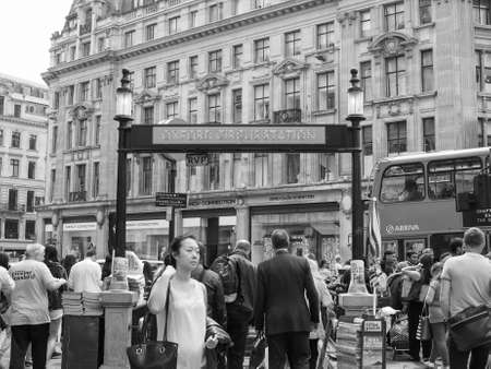 oxford: LONDON, UK - JUNE 12, 2015: Travellers at Oxford Circus underground station in black and white