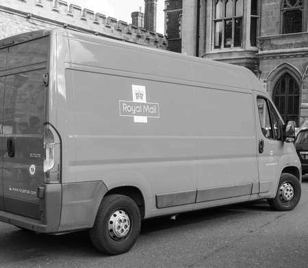 royal mail: LONDON, UK - JUNE 09, 2015: Red Royal Mail van for mail delivery in central London in black and white