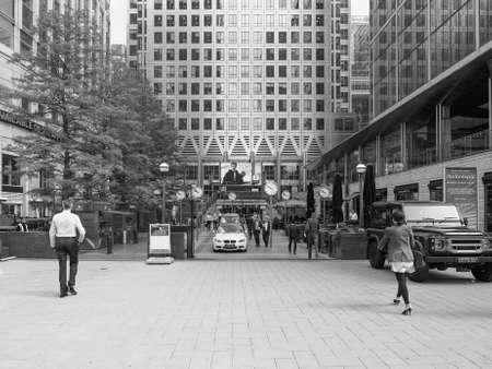 business centre: LONDON, UK - JUNE 10, 2015: Workers at the Canary Wharf business centre which is the largest business district in the United Kingdom in black and white