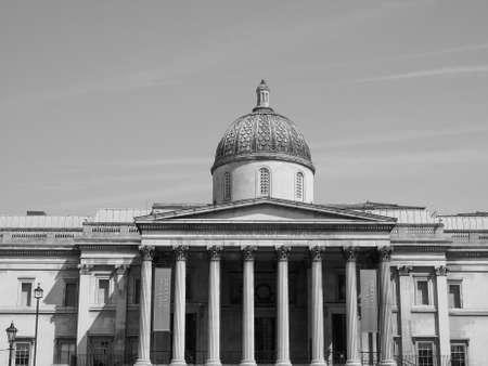 trafalgar: LONDON, UK - JUNE 11, 2015: The National Gallery in Trafalgar Square in black and white