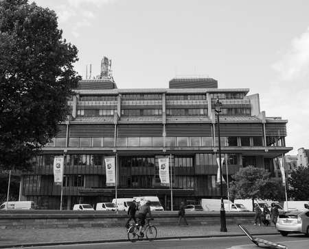 conference centre: LONDON, UK - JUNE 09, 2015: Queen Elizabeth II Centre designed by Powell and Moya is the largest conference centre in central London in black and white