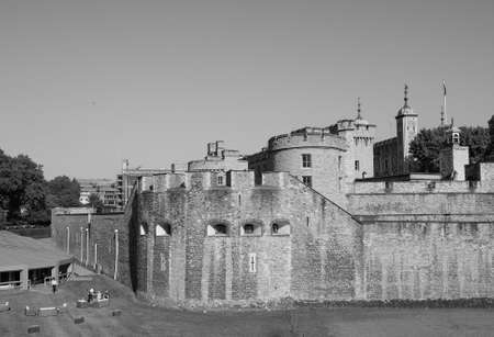 dungeons: LONDON, UK - JUNE 11, 2015: Tourists visiting the Tower of London in black and white