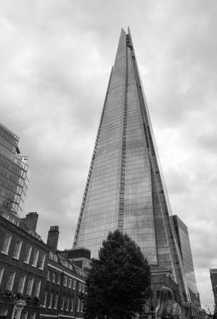 shard: LONDON, UK - JUNE 10, 2015: The Shard skyscraper designed by Italian architect Renzo Piano is the highest building in town in black and white