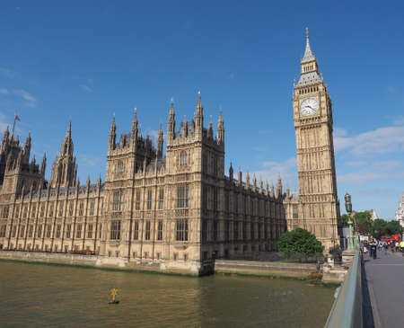 bigben: LONDON, UK - JUNE 10, 2015: Houses of Parliament aka Westminster Palace seen from Westminster Bridge