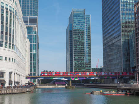 largest: LONDON, UK - JUNE 11, 2015: The Canary Wharf business centre is the largest business district in the United Kingdom
