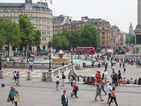 trafalgar: LONDON, UK - JUNE 12, 2015: Tourists visiting Trafalgar Square