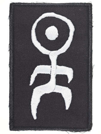 mensch: BERLIN, GERMANY - CIRCA AUGUST 2015: Logo of German industrial band Einstuerzende Neubauten on woven fabric tag for clothing