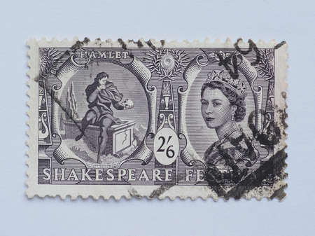 LONDON, UK - CIRCA 2015: A stamp printed by United Kingdom shows Hamlet and Her Majesty the Queen Elizabeth II Editorial