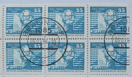 known: CHEMNITZ, GERMANY - CIRCA 2015: A stamp printed by East Germany shows the Karl Marx monument in Karl Marx Stadt, now known as Chemnitz