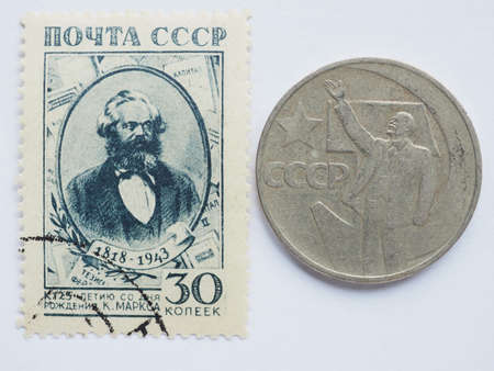 marx: MOSCOW, RUSSIA - CIRCA 2015: A stamps printed by USSR show a Karl Marx portrait and a Ruble coin shows Lenin