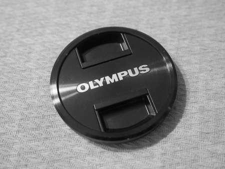 olympus: TOKYO, JAPAN - CIRCA AUGUST 2015: Olympus logo on camera lens cap