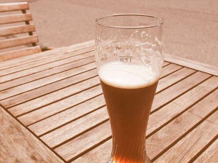 biergarten: Vintage looking A glass of German weiss beer