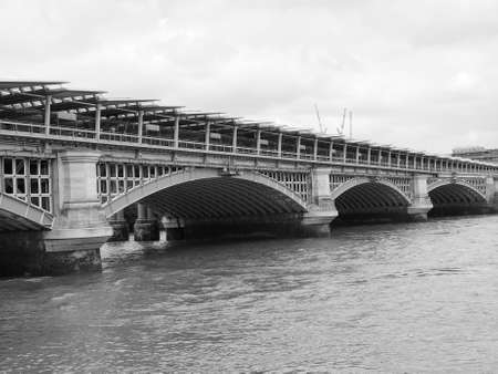 blackfriars bridge: Blackfriars Bridge over River Thames in London, UK in black and white