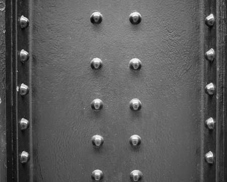 steel texture: Black steel texture useful as a background with bolts in black and white Stock Photo