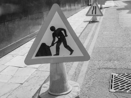 road works: Road works sign for construction works in progress in black and white