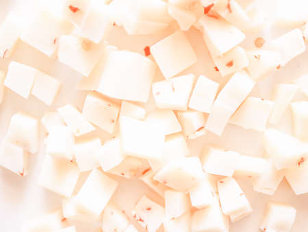 diced: Vintage looking Diced cheese with red hot chilli peppers Stock Photo