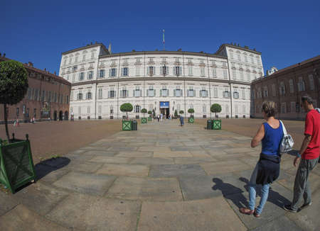 reale: TURIN, ITALY - CIRCA SEPTEMBER, 2015: Tourists visiting Palazzo Reale meaning Royal Palace seen with fisheye lens