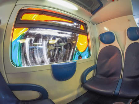 window graffiti: MILAN, ITALY - CIRCA SEPTEMBER, 2015: Train interior with graffiti on a window seen with fisheye lens