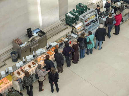 queueing: LONDON, UK - CIRCA MARCH, 2009: People queueing at the British Museum cafeteria bar in the Great Court