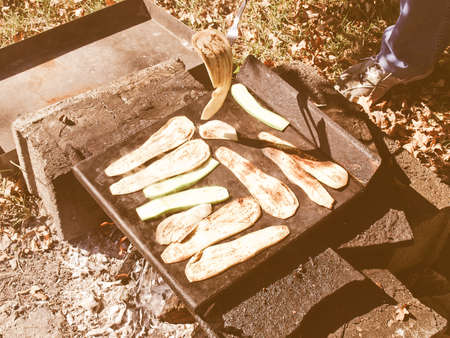 broiling: Vintage looking Barbecue BBQ with zucchini courgettes