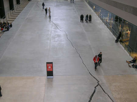 public space: LONDON, UK - CIRCA MARCH, 2008: The Turbine Hall which once housed the electricity generators of the power station is now a huge open public space part of Tate Modern art gallery in South Bank