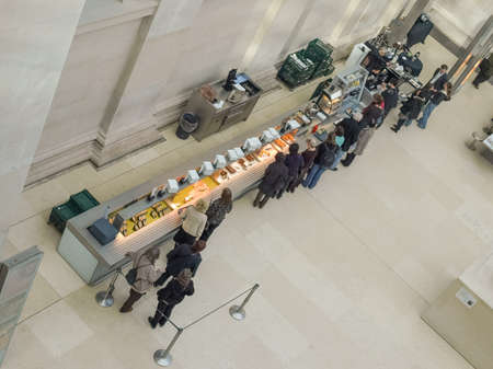 british people: LONDON, UK - CIRCA MARCH, 2009: People queueing at the British Museum cafeteria bar in the Great Court