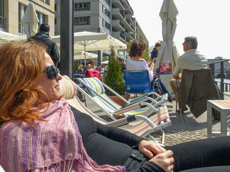 or spree: BERLIN, GERMANY - CIRCA APRIL, 2010: Tourists in a cafe by the river Spree in spring