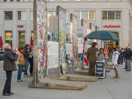 mauer: BERLIN, GERMANY - CIRCA APRIL, 2010: Tourists visiting the remains of Berliner Mauer meaning Berlin Wall