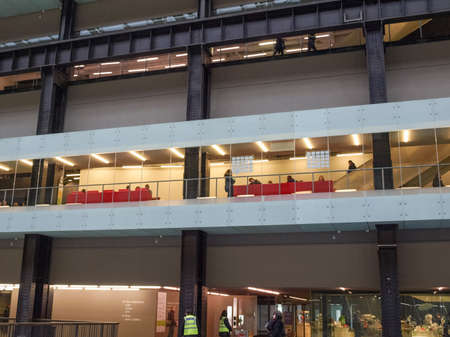 public space: LONDON, UK - CIRCA MARCH, 2009: The Turbine Hall which once housed the electricity generators of the power station is now a huge open public space part of Tate Modern art gallery in South Bank Editorial