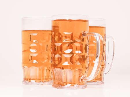 pilsner glass: Vintage looking Many large glasses of German lager beer