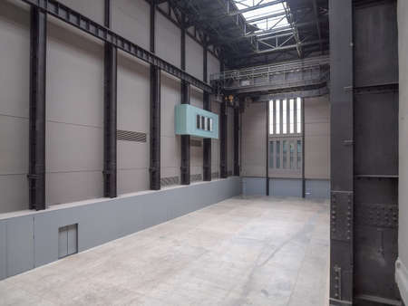 housed: LONDON, UK - CIRCA JUNE, 2011: The Turbine Hall which once housed the electricity generators of the power station is now a huge open public space part of Tate Modern art gallery in South Bank