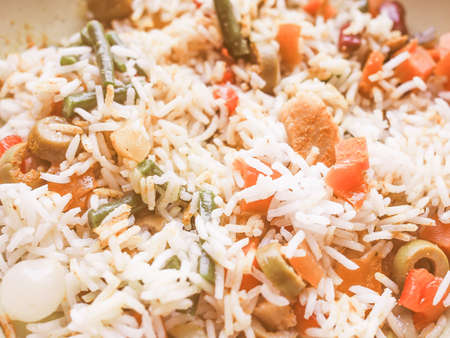 indian food: Vintage looking Curry rice with season vegetables vegetarian Indian food
