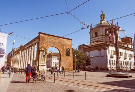 lorenzo: Vintage looking MILAN, ITALY - MARCH 28, 2015: Colonne di San Lorenzo meaning St Lawrence columns, ancient Roman ruins Milan Italy
