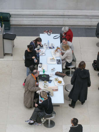 queueing: LONDON, UK - CIRCA MARCH, 2008: People queueing at the British Museum cafeteria bar in the Great Court