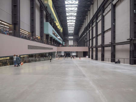 housed: LONDON, UK - CIRCA JUNE, 2011: Tourists visiting the Turbine Hall which once housed the electricity generators of the power station now part of Tate Modern art gallery in South Bank