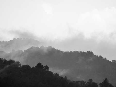 awe: Sublime awe inspiring nature in stormy weather in black and white