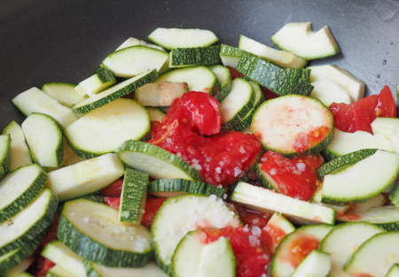 courgettes: Courgettes vegetables with tomato sauce in a frying pan