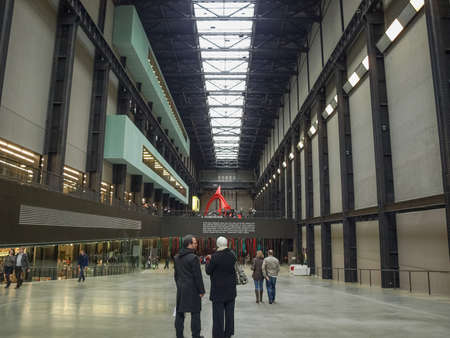 housed: LONDON, UK - CIRCA MARCH, 2009: The Turbine Hall which once housed the electricity generators of the power station is now a huge open public space part of Tate Modern art gallery in South Bank Editorial