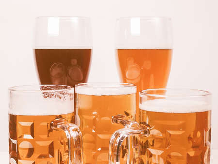 pilsner beer glass: Vintage looking Many glasses of German beers including weiss dunkel and lager Stock Photo