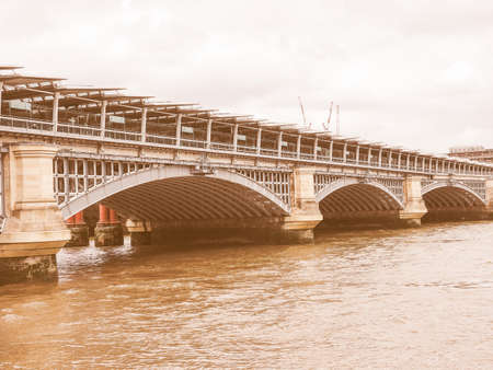 blackfriars bridge: Vintage looking Blackfriars Bridge over River Thames in London, UK Stock Photo