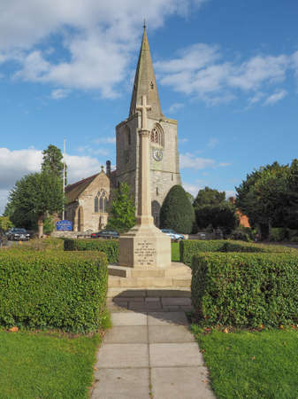 arden: TANWORTH IN ARDEN, UK - SEPTEMBER 25, 2015: The Village Green with St Mary Magdalene church and war memorial