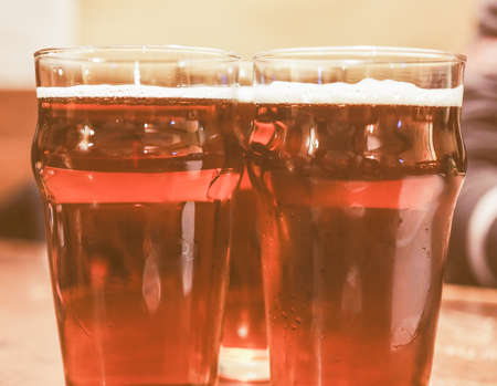 alcoholic drink: Vintage looking Three pints of beer alcoholic drink Stock Photo