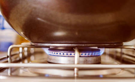 gas cooker: Vintage looking Saucepan on a gas cooker