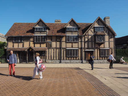 birthplace: STRATFORD UPON AVON, UK - SEPTEMBER 26, 2015: Tourists in front of William Shakespeare birthplace